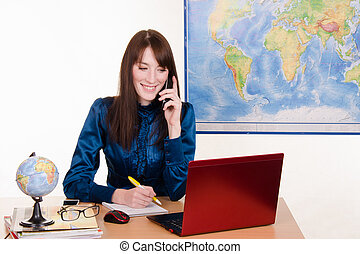 Office manager travel agency on the phone - Young beautiful...