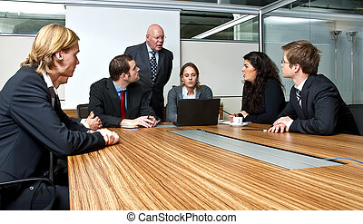 Office Meeting - A company manager, and his team, discussing...
