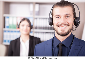 Office of customer support line with people working in it
