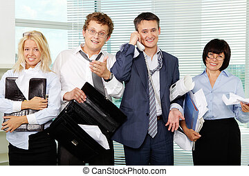Group of crazy businesspeople after hard working day