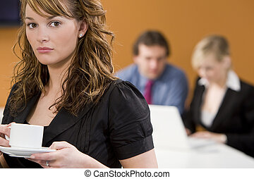 Office Politics - An attractive young female executive takes...