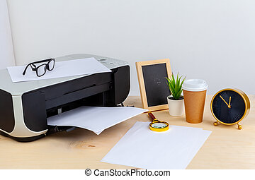 Office printer close up on a wooden table