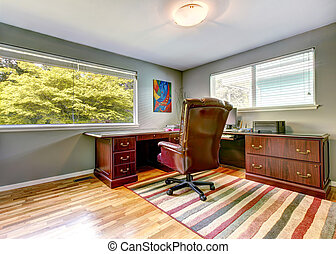 Office room interior - Office room with wooden desk,...