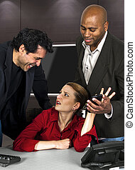 Office Sexual Harrassment - employees in an office