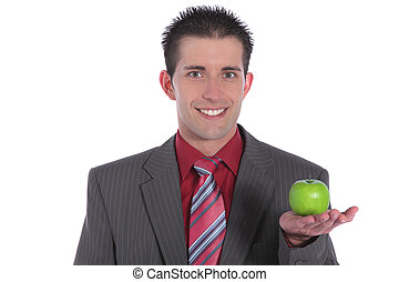 Office snack - A handsome businessman holding a fine green...