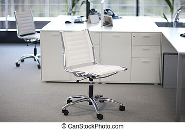 Office space - Two chairs and desks inside an office...