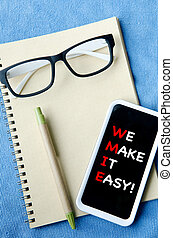 Office supplies Notebook paper smartphone and glasses