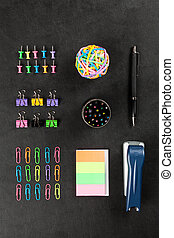 Office supplies on a black table