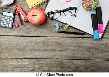 Office supplies on grey wooden background