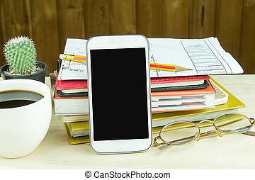 office supplies on wooden table with coffee