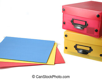 office supplies - colorful boxes and file folders for the...