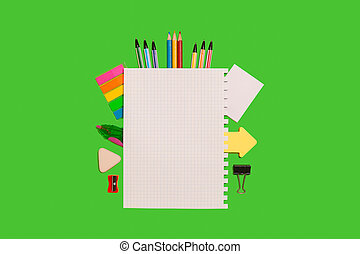 office supplies surrounding a sheet of paper