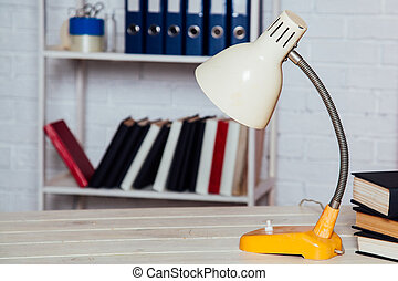 Office table dump books folders business lamp