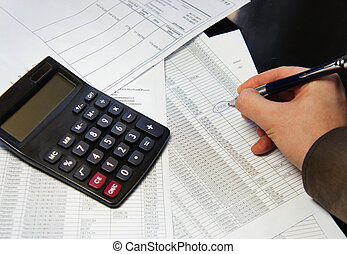 Office table with calculator, pen and accounting document