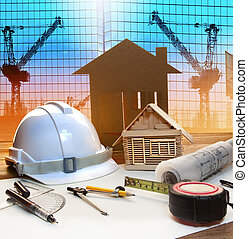 office tower and home construction plan on architect working table with modern building and crane background use for civil engineer and architectural backdrop scene