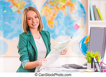 Office Travel Agency - Portrait of a young woman chooses a...