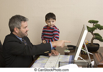 Office Visit - Office working talking to small child sitting...