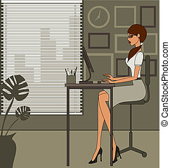 Office Woman - A young and attractive woman working on ...