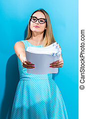 Office woman with a stack of documents