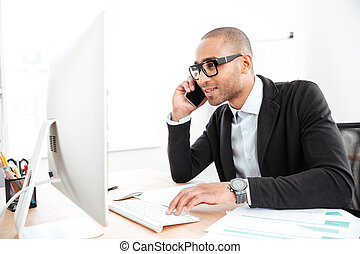 Office worker calling on the phone and reading business document