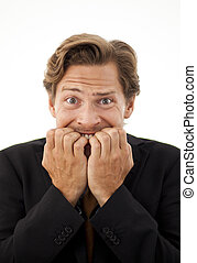 Office worker chewing on his fingernails with a worried...