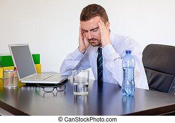 Office worker feeling pain because of headache