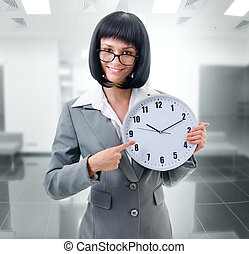 office worker holding big clock