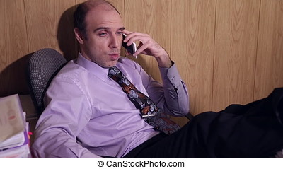 Office worker is talking on the mobile phone