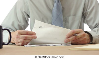Office worker or secretary checks through some report document papers and then signs them.