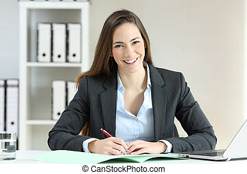 Office worker posing looking at camera
