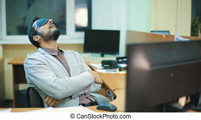 Office Worker sleeping at work - Young executive sleeping at...