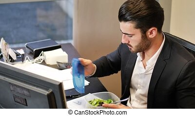 Office worker talking and eating - Elegant man in suit...