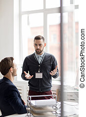 Office Worker Talking to Colleague