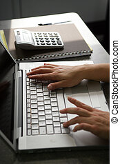 Office worker typing on a laptop