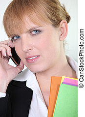 Office worker using a mobile phone