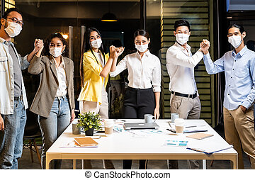 Office worker wear face mask in meeting room alternative greeting in new normal lifestyle