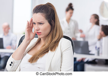 Office worker with pregnancy symptoms - Image of female...