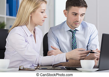 Office workers analyzing problem