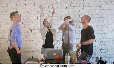 Office workers dance, celebrate the victory, fail to throw...