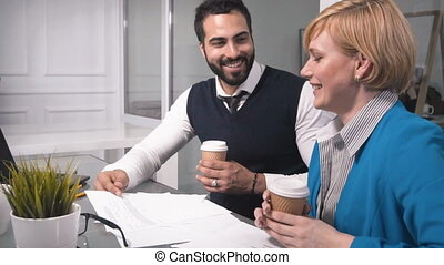Office Workers Drink Coffee During Discussion