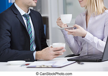 Office workers drinking coffee
