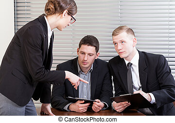 Office workers during meeting with manager