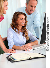 Office workers in a training course