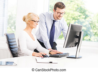 Office workers in formalwear working using computers