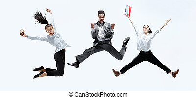 Office workers jumping isolated on studio background