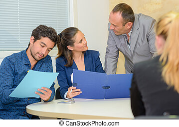 Office workers looking at files