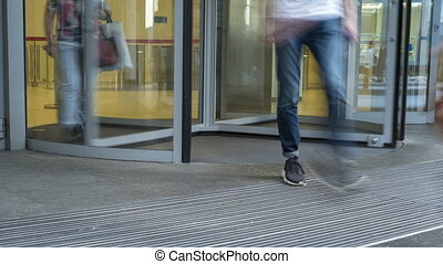 Office workers pass through entrance doors, time lapse