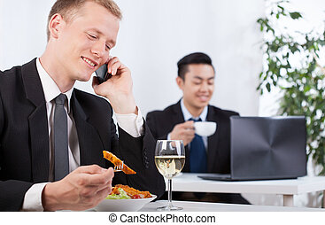 Office workers taking a break for lunch