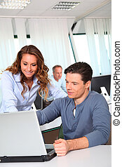 Office workers with laptop computer