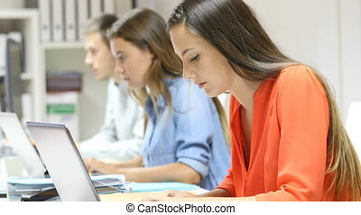 Office workers working online - Side view of three office...